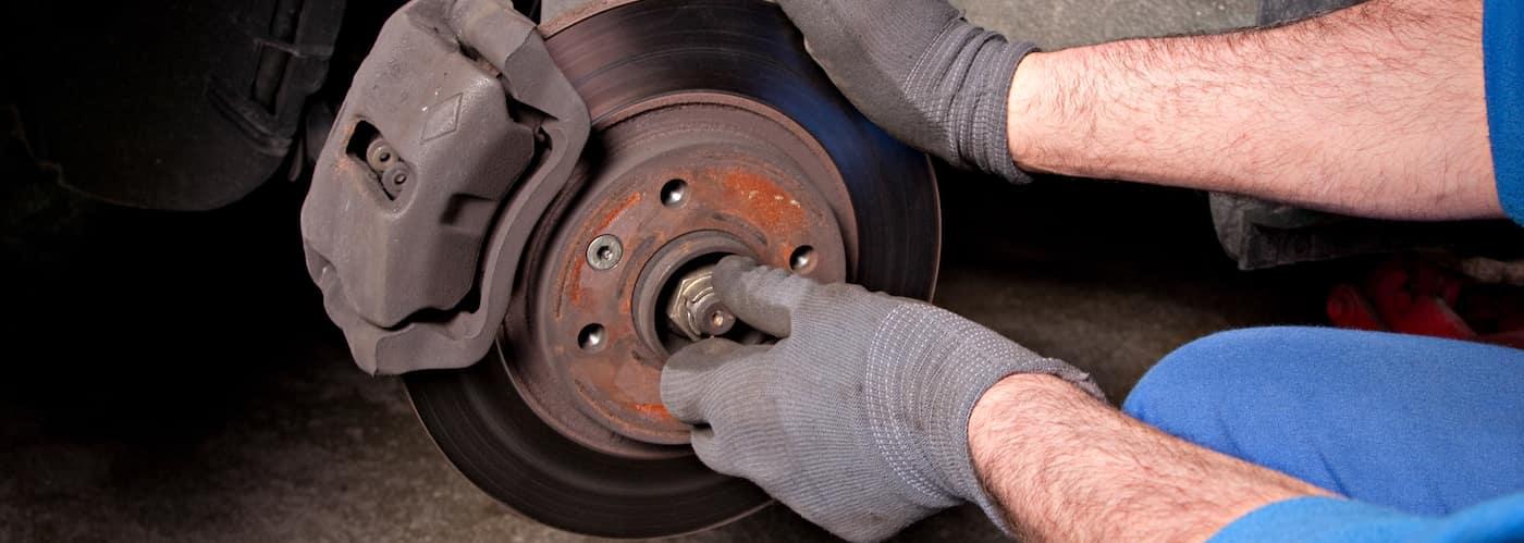 Mechanic Changing Brakes