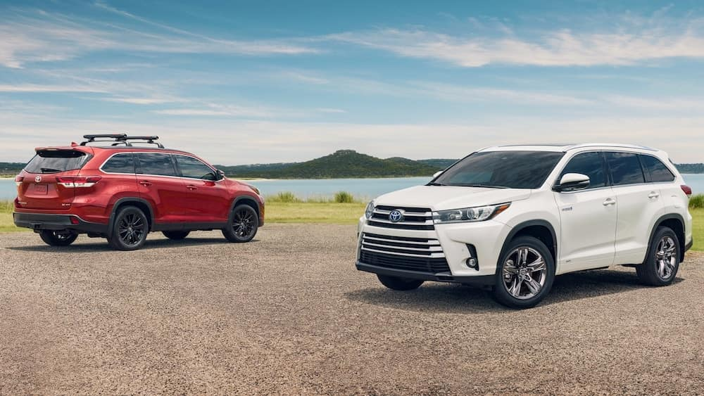 Red and White 2019 Toyota Highlander SUVs