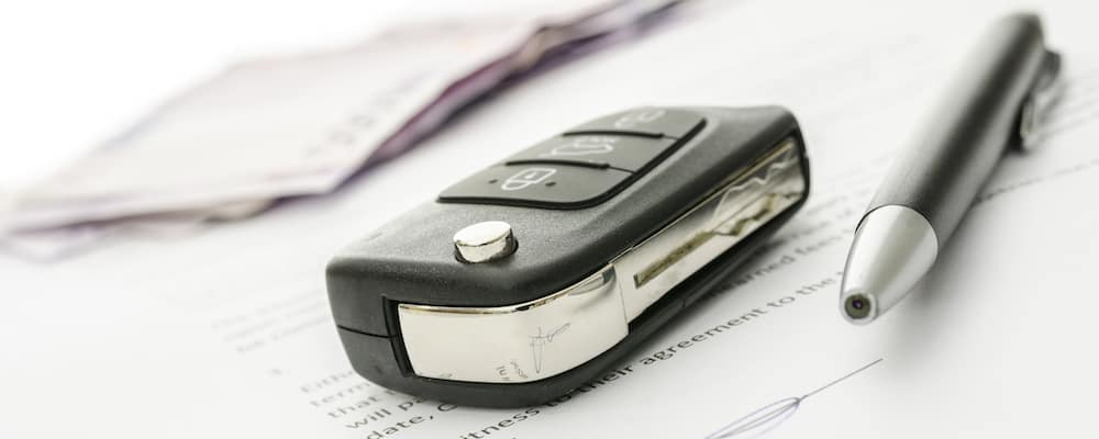 Car Key and Pen on Contract
