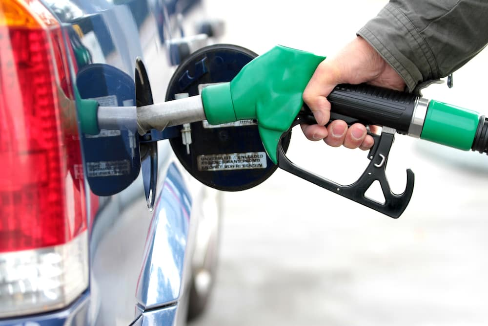 Green Gas Pump Filling Car