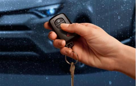 Hand Holding Toyota Key Fob