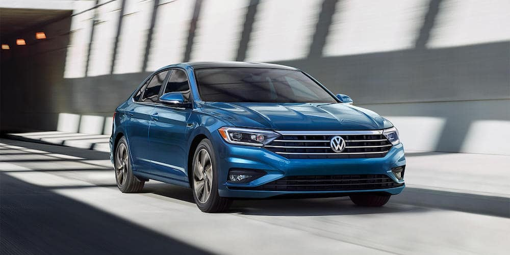 blue 2019 jetta on highway