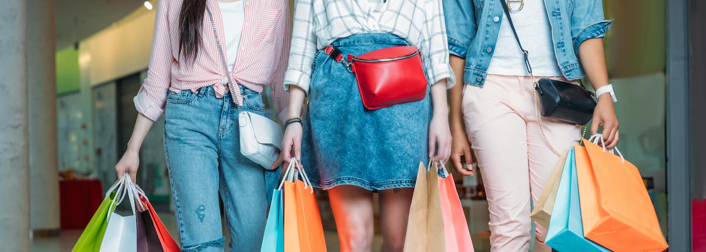 young women with brightly colored shopping bags