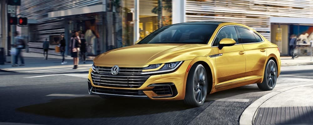 Gold 2019 VW Areton Turning Street Corner
