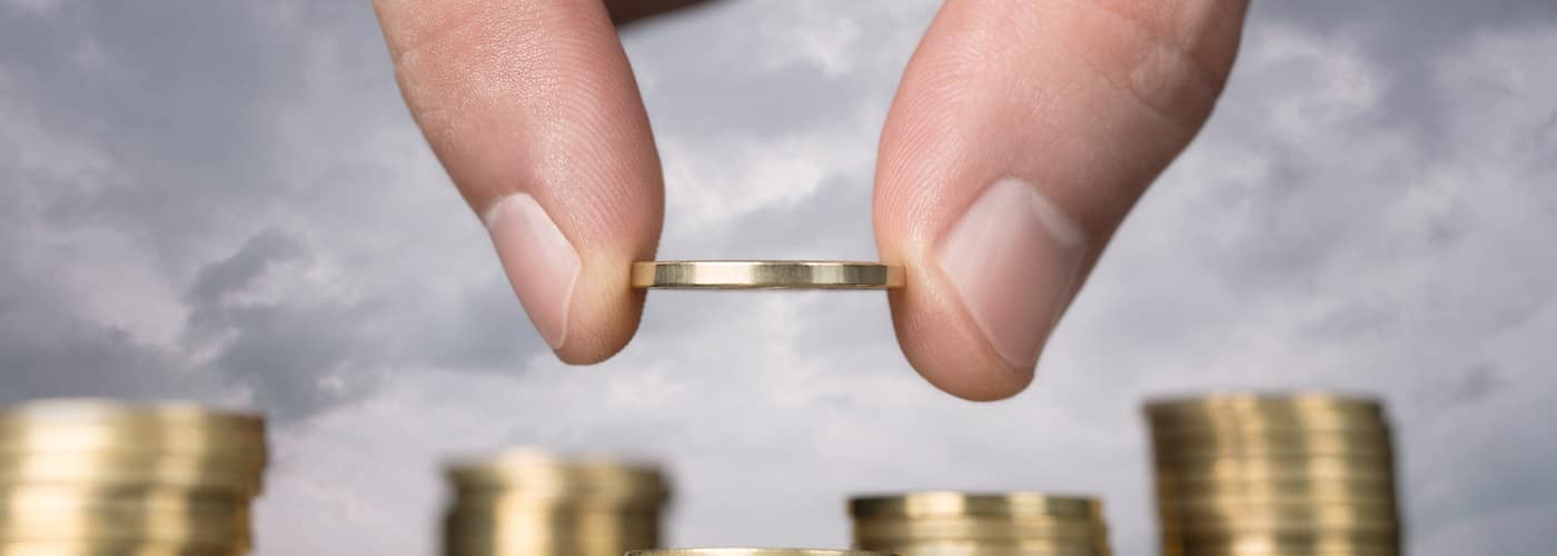 Hand Holding Coin