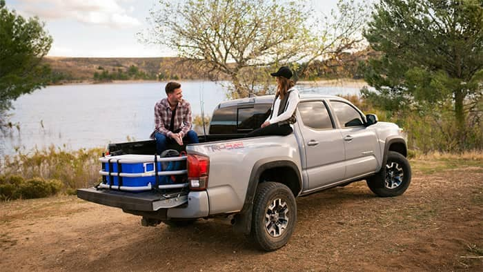 2019 Toyota Tacoma Parked by Lake with Couple Sitting in Back