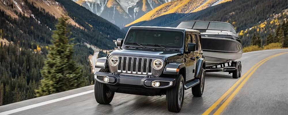 2019 Jeep Wrangler towing a boat