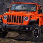 Orange 2019 Jeep Wrangler on rocky ground