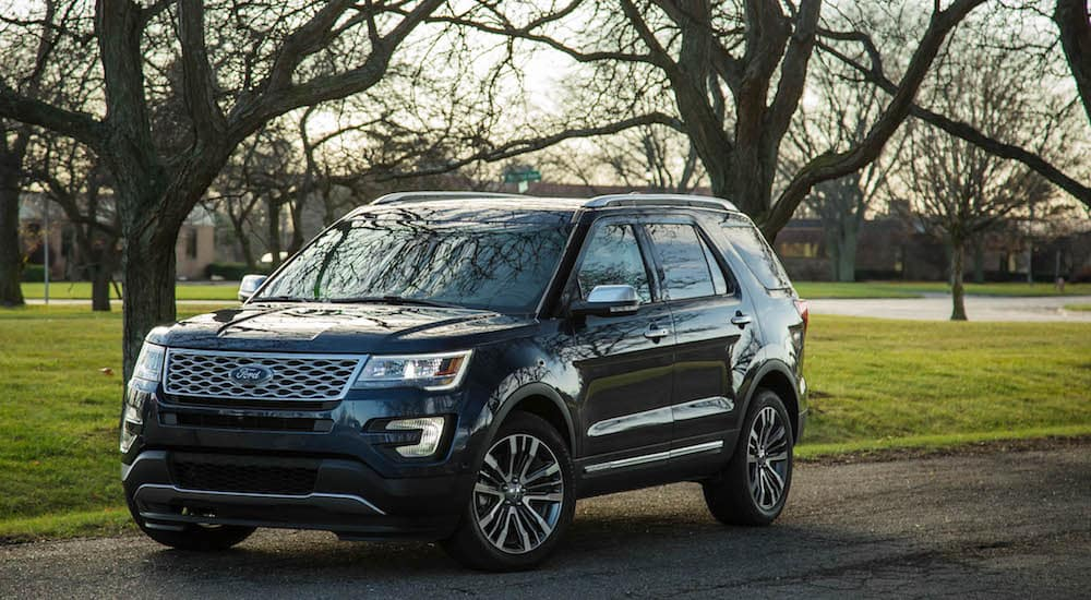 A Black 2018 Ford Explorer in front of trees in Carbondale