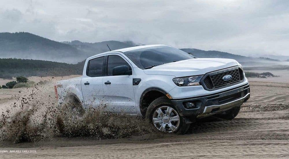 A white 2019 Ford Ranger blasts through a local sand pit