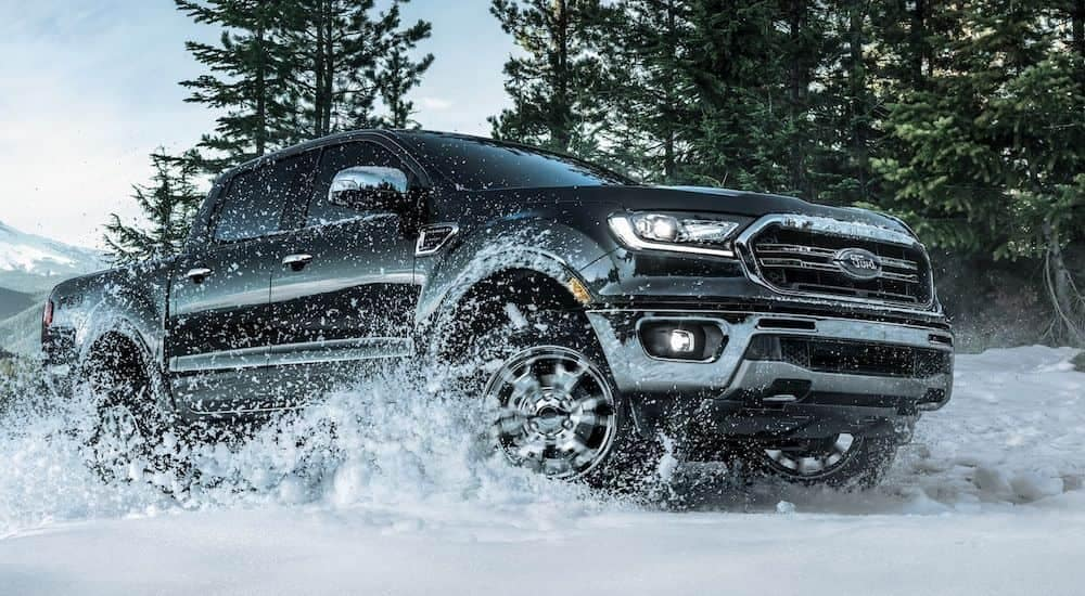 A black 2019 Ford Ranger from a Carbondale Illinois Ford Dealership powers through some deep snow in four-wheel-drive
