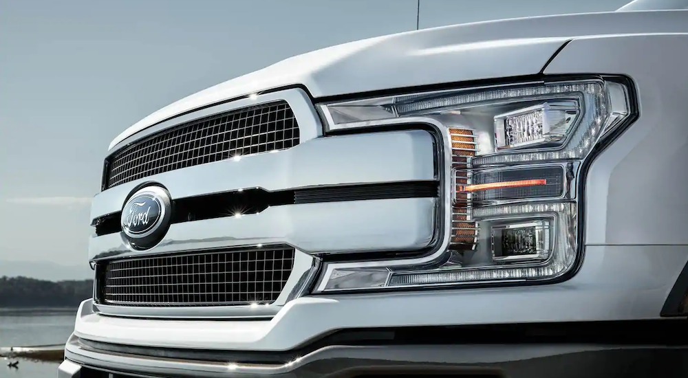 A close up of a white 2019 Ford F-150 grille is shown.