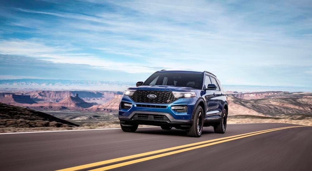 A blue 2020 Ford Explorer travels a open highway.