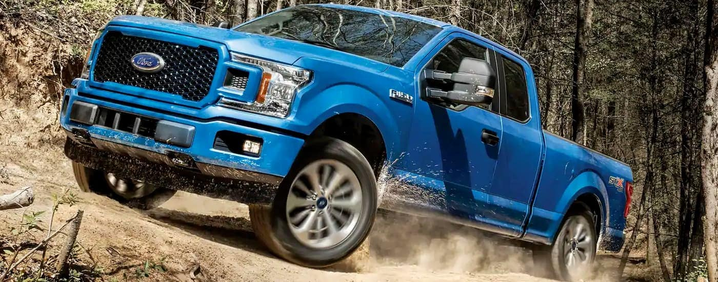 A blue 2019 Ford F-150 is off-road. Find a similar Ford F-150 for sale at a dealer in Carbondale, IL.