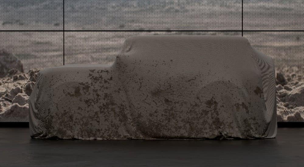 The future 2020 Ford Bronco, soon to be popular among Ford SUVs for sale, is shown covered.