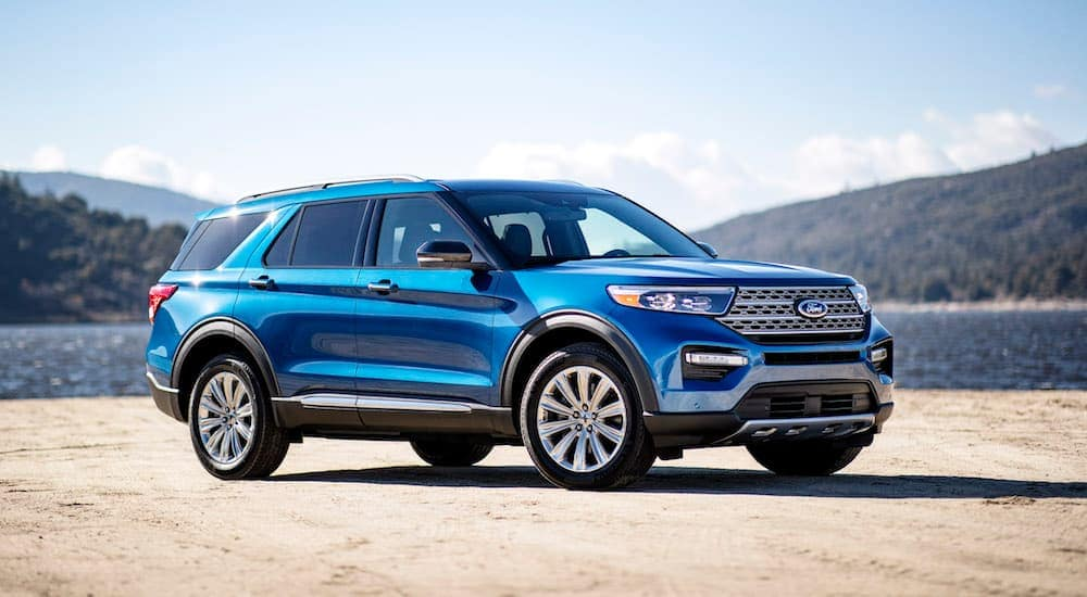 A blue 2020 Ford Explorer is parked next to a lake after leaving a Ford dealership near Carbondale, IL.