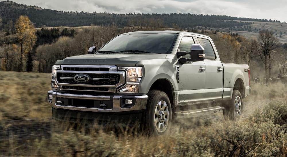 A silver 2020 Ford Super Duty is parked in a grassy field near Carbondale, IL.