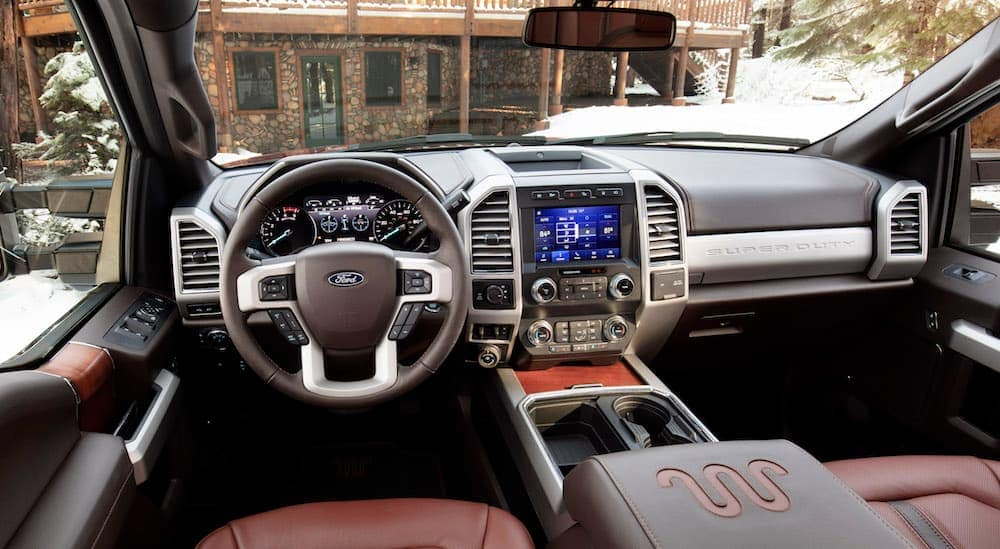 The red leather interior of a 2020 Ford Super Duty King Ranch Edition, which is similar to one that you can find at a Ford Dealership in Carbondale, IL, is shown.