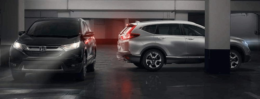 two honda cr-v configurations in parking garage