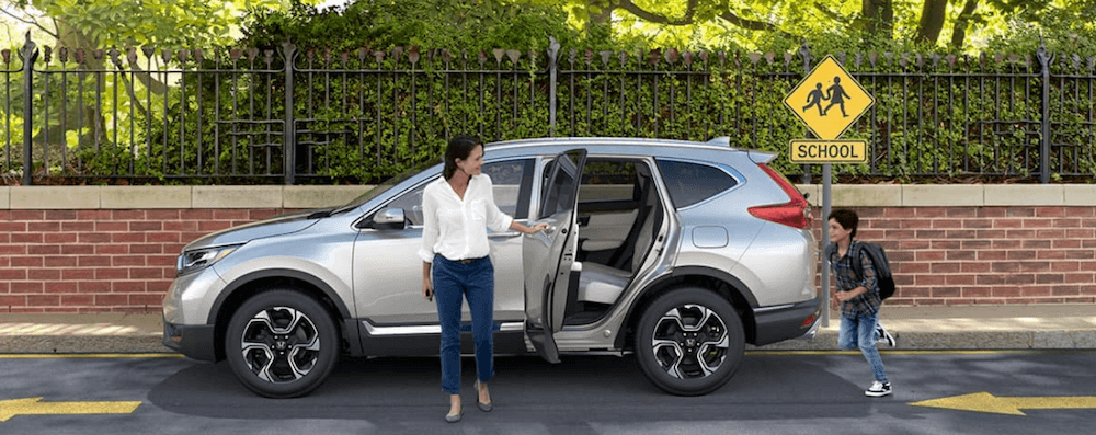 2019 Honda CR-V with mother and child near crosswalk