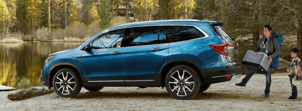 2020 Honda Pilot with father and and son loading cargo space