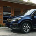 2020 Honda Pilot in driveway near woman