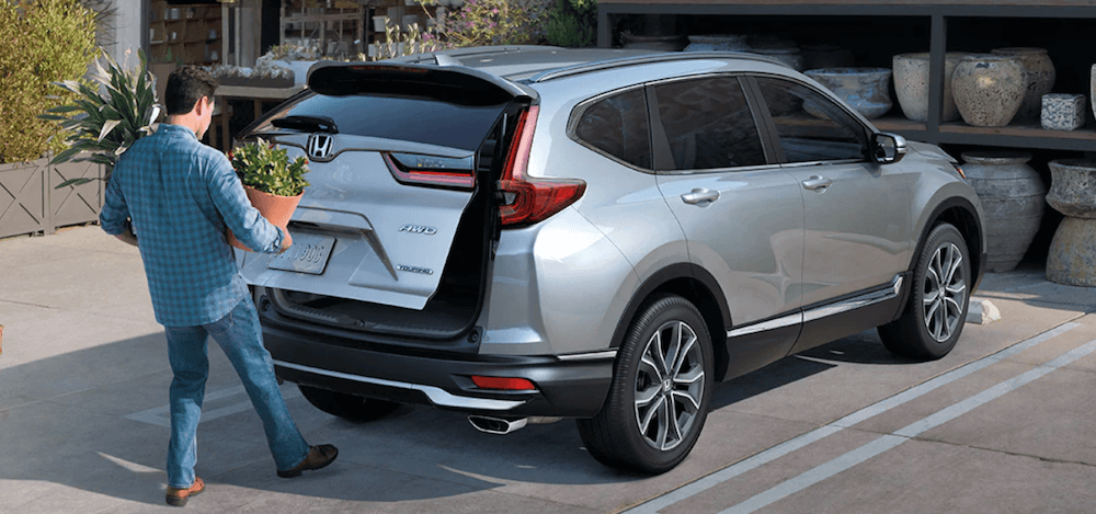 2020 Honda CR-V with man loading trunk cargo
