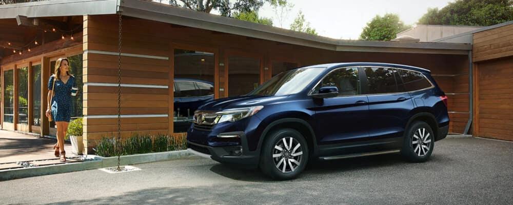 2021 Honda Pilot parked at modern home