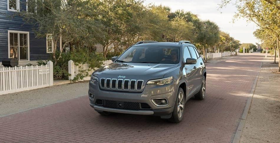 man drives 2019 Jeep Cherokee